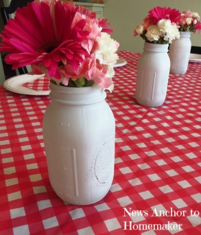 Spray Painted Mason Jars with Flowers, perfect Baby Shower decoration www.newsanchortohomemaker.com